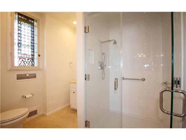 This image has an empty alt attribute; its file name is bathroom-shower-and-vanity-before.jpg